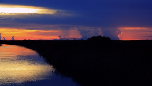 sunset calm serene nature beauty natural hometown florida unitedstates usa floridaeverglades dusk riverofgrass open space colorful dramatic composition southflorida broward river grass coralspringsflorida outdoor sky horizon bytheriverbank west cloud landscape water ariverrunsthroughit rivermood moodyriver scape highsky bigsky moody light dirtroad dike cloudcover road citylights bright blue aroundthebend curve