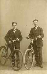 two men with their bikes ca. 1910