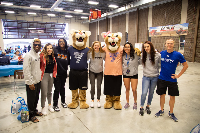Students smile with Bart and Miss Kitty at 50th celebration event