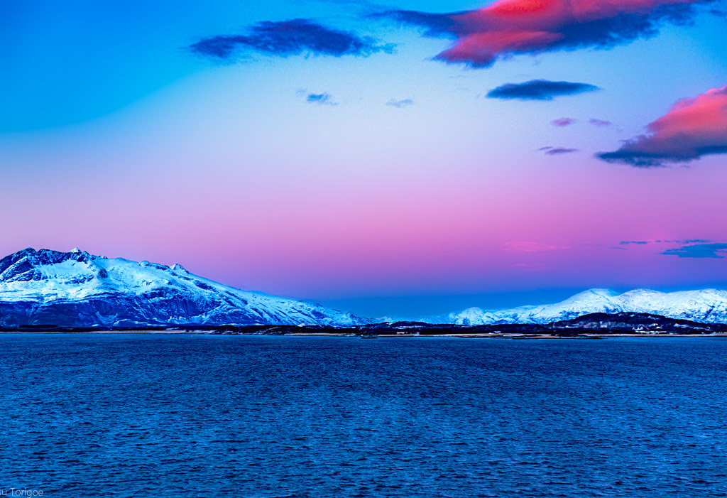 Colorful sunset view of landscape along the mouth of Vefsnfjorden between Mindlandet and Tjotta Islands, Norway-19a