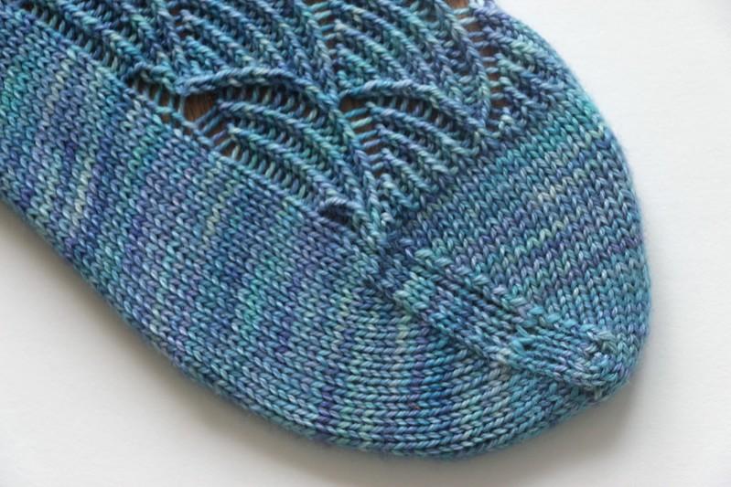 Detail of handknit Pomatomus sock on sock blocker, showing toe