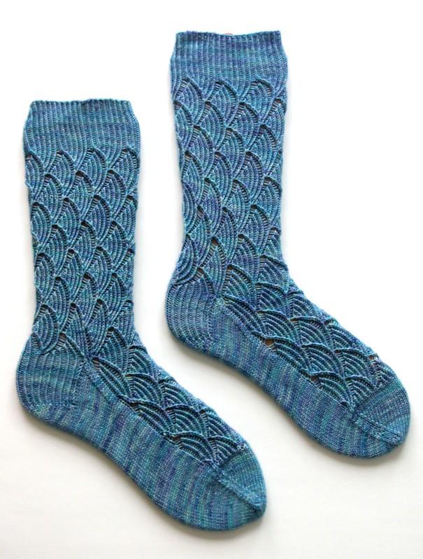 Handknit Pomatomus socks, side-by-side on sock blockers