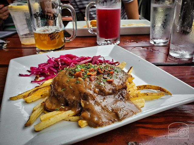 Jagerschnitzel - thinly sliced & breaded pork loin, bacon mushroom gravy, hand cut fries, braised red cabbage  - Morgantown Brewing Company