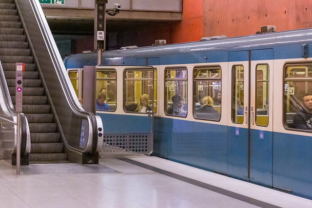 Public transport in Munich, Germany: subway station with train and escalator