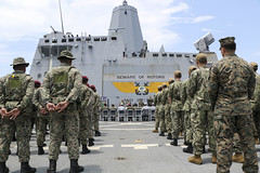 U.S. Marines and Sailors, and members of the Malaysian Armed Forces stand in ranks aboard USS Green Bay (LPD 20) the opening ceremony for exercise Tiger Strike, Sept. 30. (U.S. Navy/MC2 Anaid Banuelos Rodriguez)