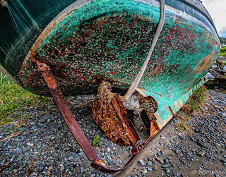 Rust, rope and a boat.