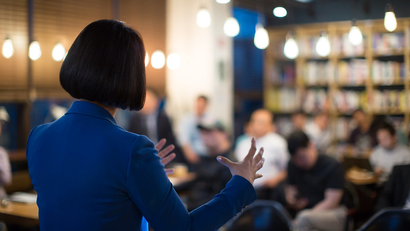 Woman speaking to students
