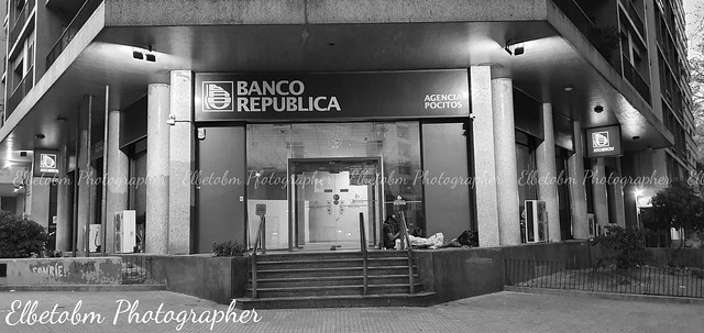 ONE PLACE - TWO WORLDS(2). HOMELESS MAN IN A DOOR OF A BANK