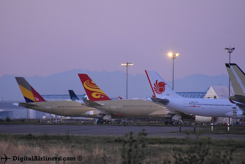 A380 Flightline at dawn.. item of interest being Asiana A350 msn 387 | by DigitalAirliners.com