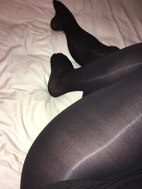 Legs in opaque black tights