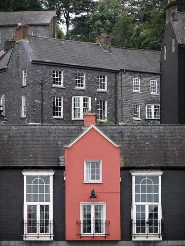 A pink house stands out among the grey ones in Kinsale, Ireland