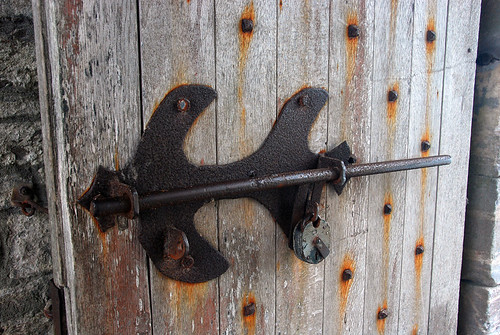 The metal bolt on a door in the ruins of Charles Fort in Kinsale, Ireland