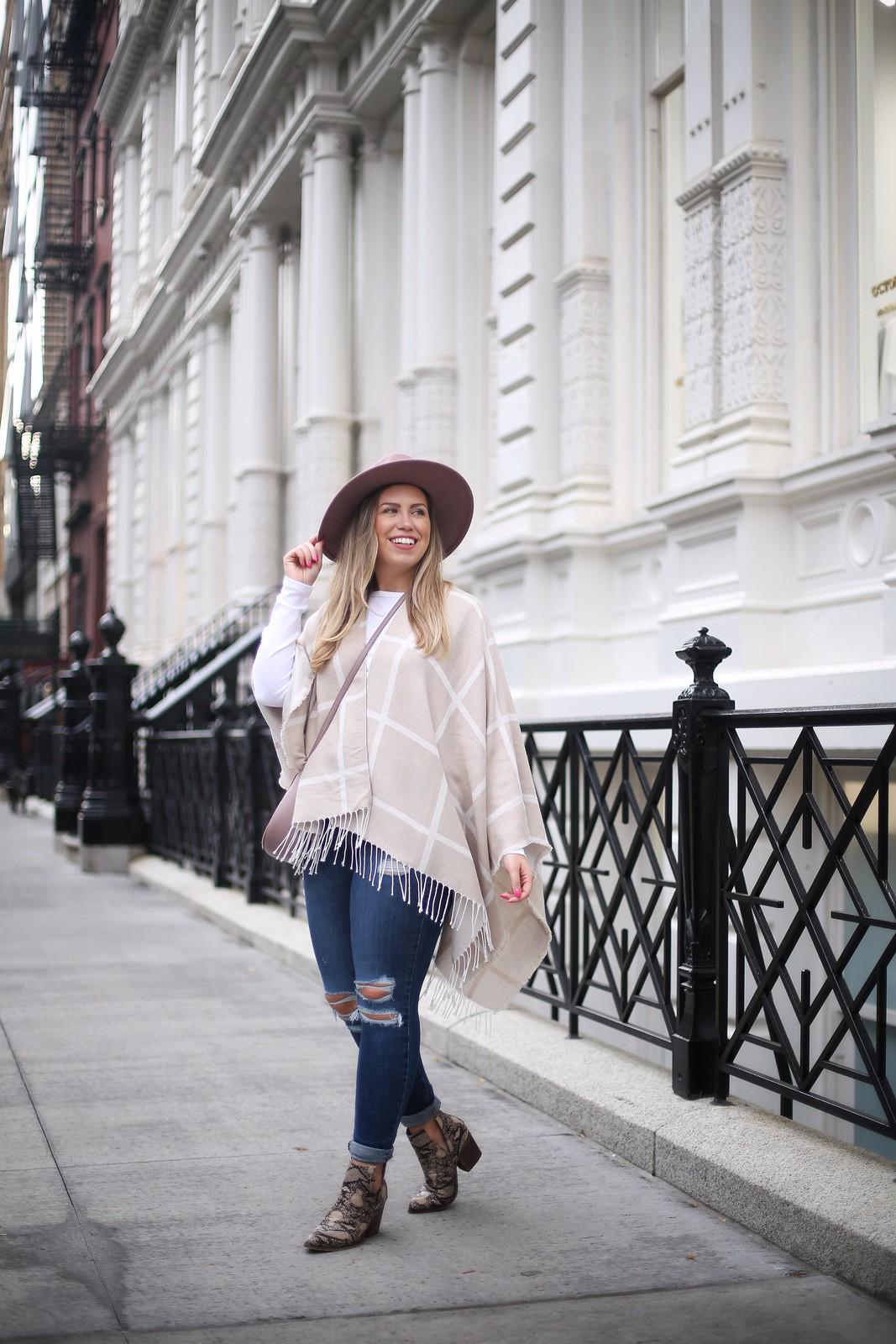 The Under $150 Fall Outfit Your Closet | New York City Street Style | Cream Plaid Cape | Levis 721 Jeans | Snake Skin Booties | Neutral Fall Look Inspiration