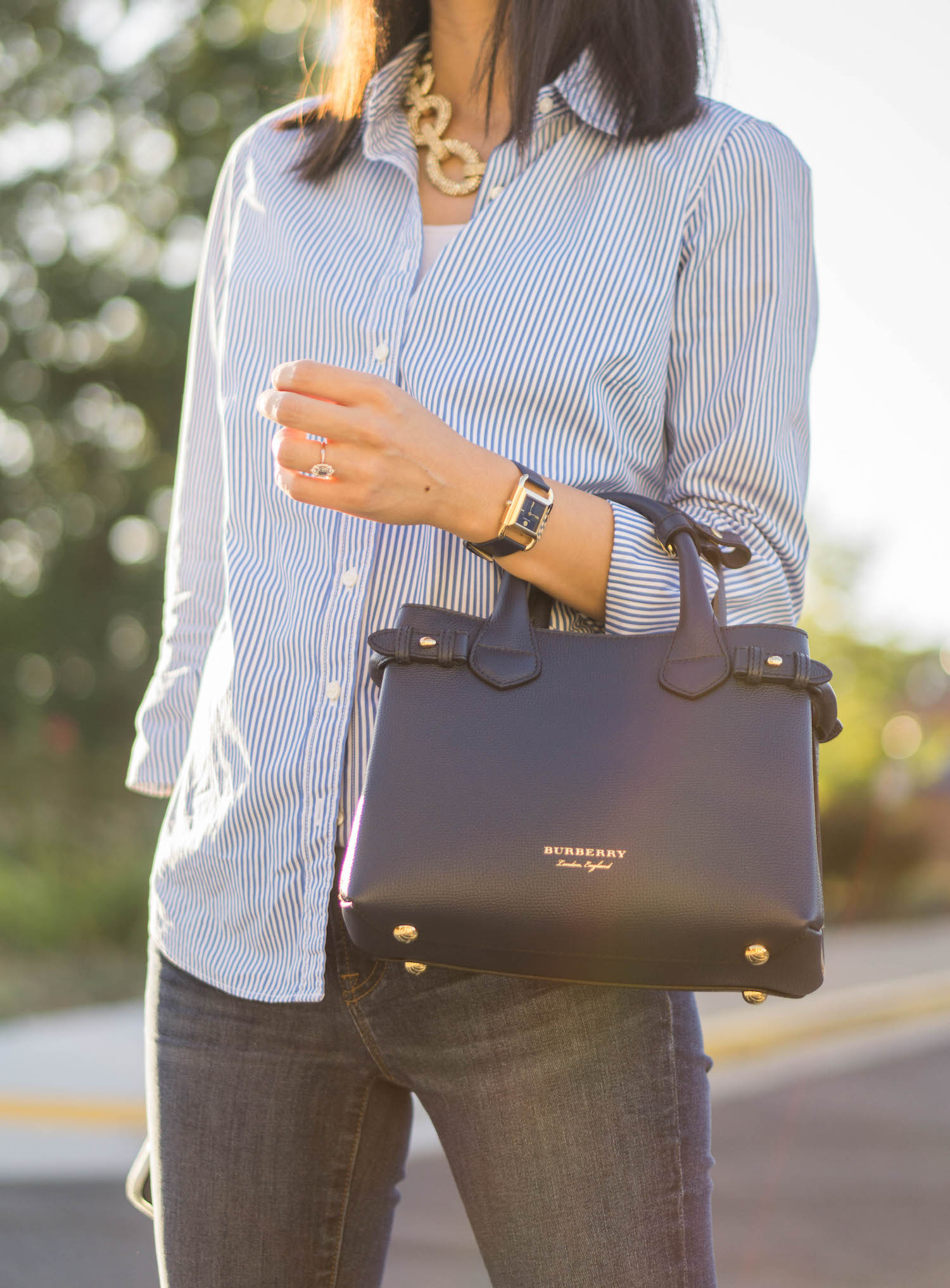"""Ann Taylor pave chain necklace, J.Crew Factory striped classic button-up shirt, Tory Burch Phipps leather strap watch, Burberry small Banner bag, J.Crew 8"""" toothpick jean in Vista wash"""