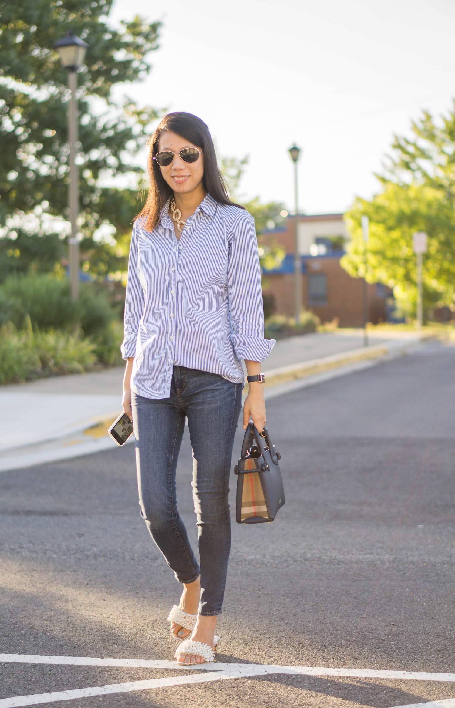 """Ann Taylor pave chain necklace, J.Crew Factory striped classic button-up shirt, Tory Burch Phipps leather strap watch, Burberry small Banner bag, J.Crew 8"""" toothpick jean in Vista wash, Tory Burch Tatiana slide"""