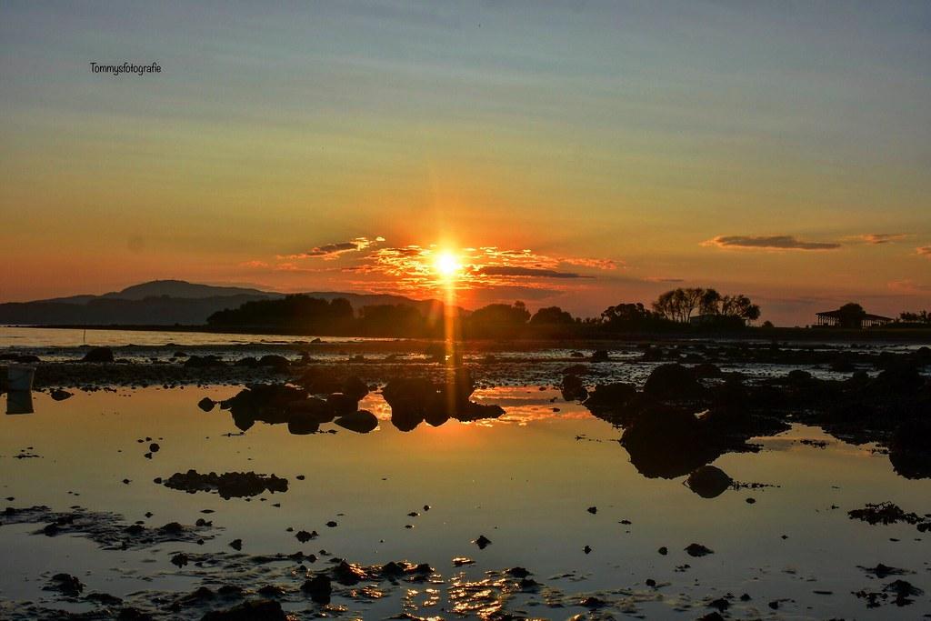 Sunrise on lowtide beach