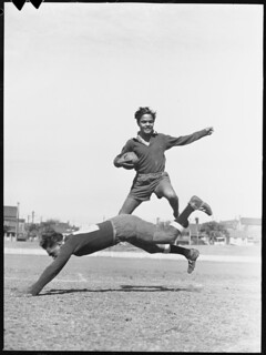 """""""Mick"""" Williams leaps a fellow player, Redfern All Blacks, 24 August 1946"""