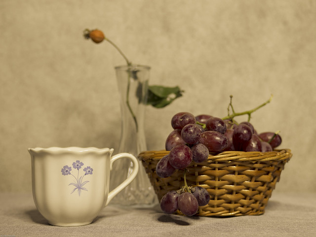 Bone China teacup, Basket with grapes and Vase with rosehip
