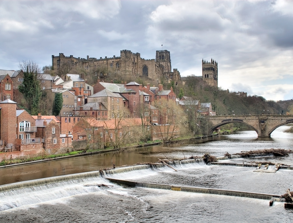 A view of Durham cathedral and castle and part of the city with the River Weir in the foreground