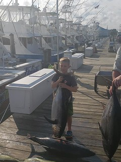 Photo of boy holding a large longfin albacore