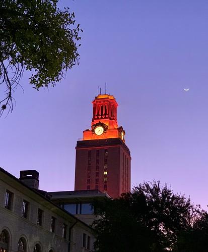 Burnt orange UT Tower and crescent moon