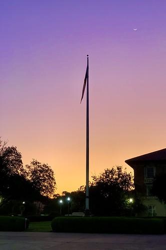 Texas flag and crescent moon, pre-dawn, UT campus