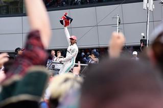 Lewis Hamilton celebrates with the crowd