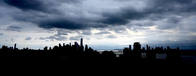 Sunlight Breaking through the Clouds in the Distance over New York Harbor