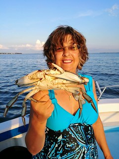 Photo of woman holding a whopper-sized crab