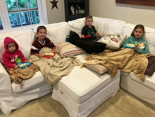 kids watching a movie and eating snacks
