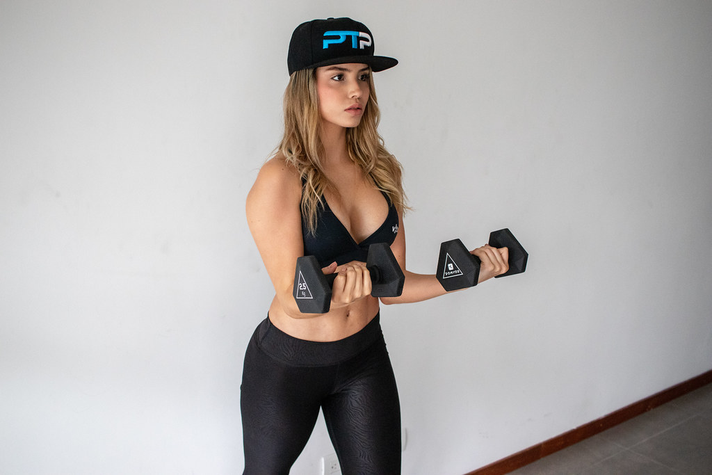 Girl doing double dumbbell bicep curl