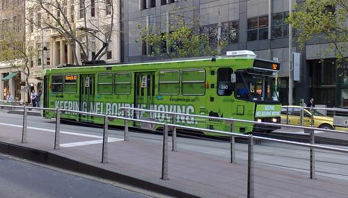 """Keeping Melbourne Moving"" tram in Collins St, September 2009"