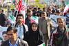 Iranian people demonstrate in streets of Tehran celebrating Islamic Revolution anniversary by German Vogel