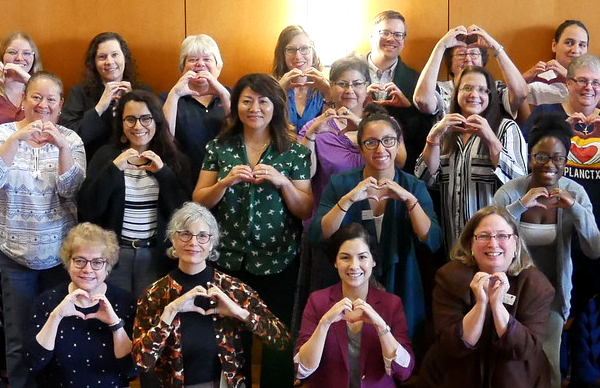 Hearts of Texas representatives showing their love for the Hearts of Texas campaign