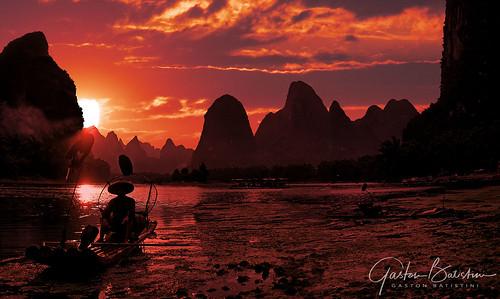 Fisherman, Li river, Near Yangshuo, Guangxi province, China