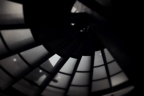 Metal and glass spiral staircase in Argentina viewed from below run through the photo app Stackables