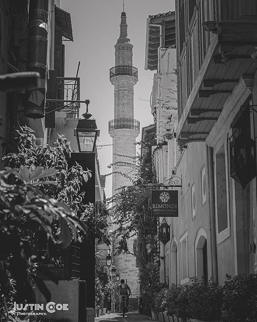 Upon walking past a lane in Rethymno I noticed Neratze mosque in the distance and a cyclist mounting his bike. · · · · · #bnw #crete #blackandwhite #travel #rethymno #blackandwhitephotography #travelphotography #bw #greece #blackandwhitephoto #travelgram