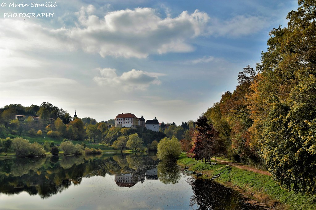 Ozalj, Karlovac County, Croatia - Autumn colors on river under the old castle