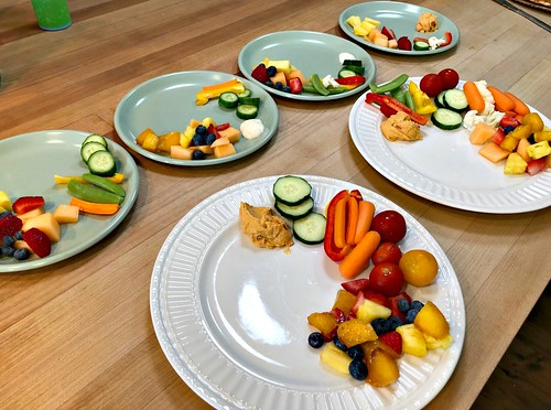 plates full of fruit and veggies