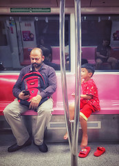 Man and boy in reds