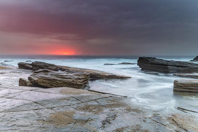 Moody Sunrise Rocky Seascape