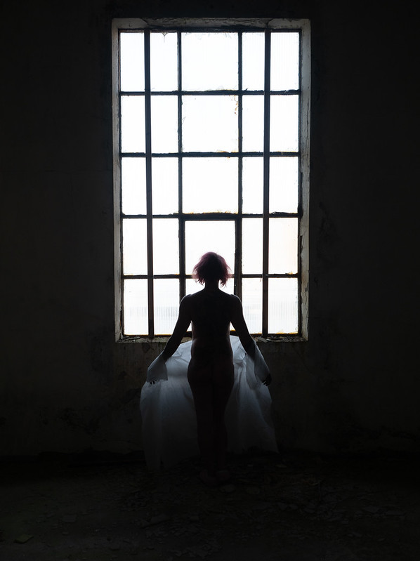Nude in front of window