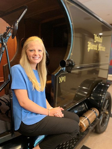 Gabby Burns sits in a restored Model T UPS delivery vehicle.