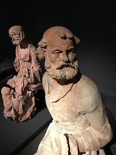 Coimbra, Portugal - Museu Machado de Castro - terracotta sculpture of the last supper - the Apostle Peter and ??? in the background