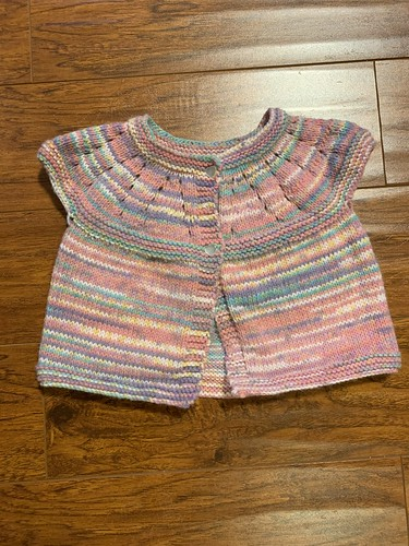 Dianne knit this super sweet little sweater using Sirdar Snuggly Baby Crofter DK