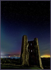 Hadleigh Castle, S.Essex,  at night with lights from Southend Pier in distance.