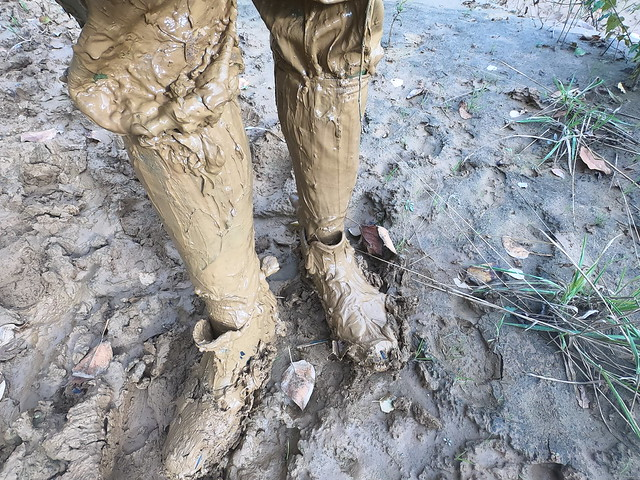 Rubber riding boots short in mud quarry