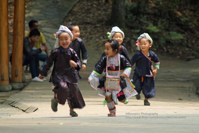 Congjiang, Basha Miao village, kids having fun
