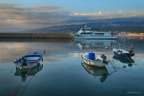ship ferry ferryboat boat reflection sea water sky clouds landscape wall krk croatia adriatic europe hrvatska canon port shore