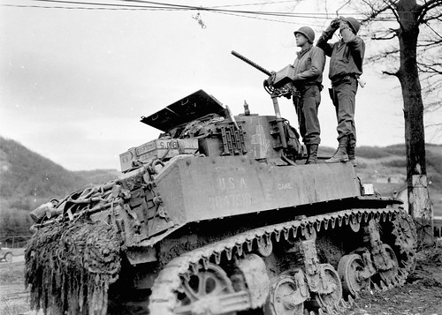 M5 Stuart named Cake, of the 3rd Armored  watching an Luftwaffe air strike in the Ardennes 18th Dec 1944.